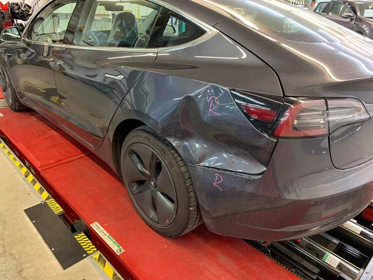 Tesla with Collision Damage